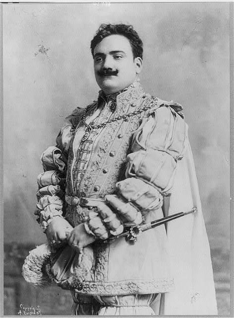 [Enrico Caruso, 1873-1921, half-length portrait, facing left, in costume]