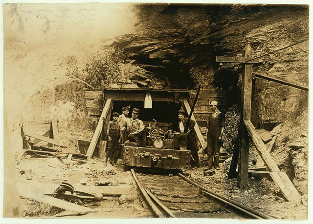 "Entrance to a W. Va. coal mine: a ""drift"" mine. The live-wire was only shoulder -high in places inside, and unprotected.  Location: West Virginia."