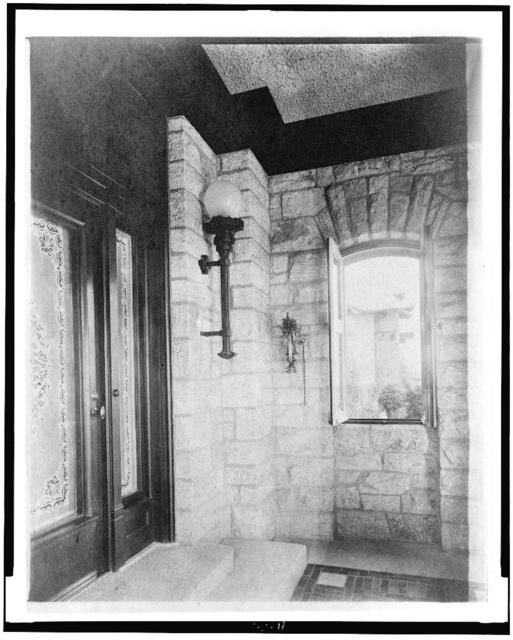 [Entrance with etched glass door at left, sconce, and open window, in home of Edmund Cogswell Converse, Greenwich, Connecticut]