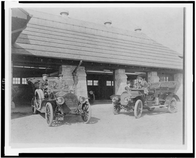 [Four men with two automobiles outside of garage of Edmund Cogswell Converse, Greenwich, Connecticut]
