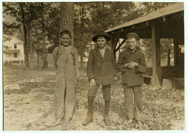 Gastonia, N.C. Boy on right hand works nights. Sunday, November 9 [i.e., 8?], 1908.  This mill was running nights at the time this photograph was taken.  Location: Gastonia, North Carolina / Photo by Lewis W. Hine.