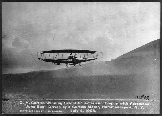 "G.H. Curtiss winning Scientific American Trophy with aeroplane ""June Bug,"" driven by a Curtiss Motor, Hammondsport, N.Y., July 4, 1908"