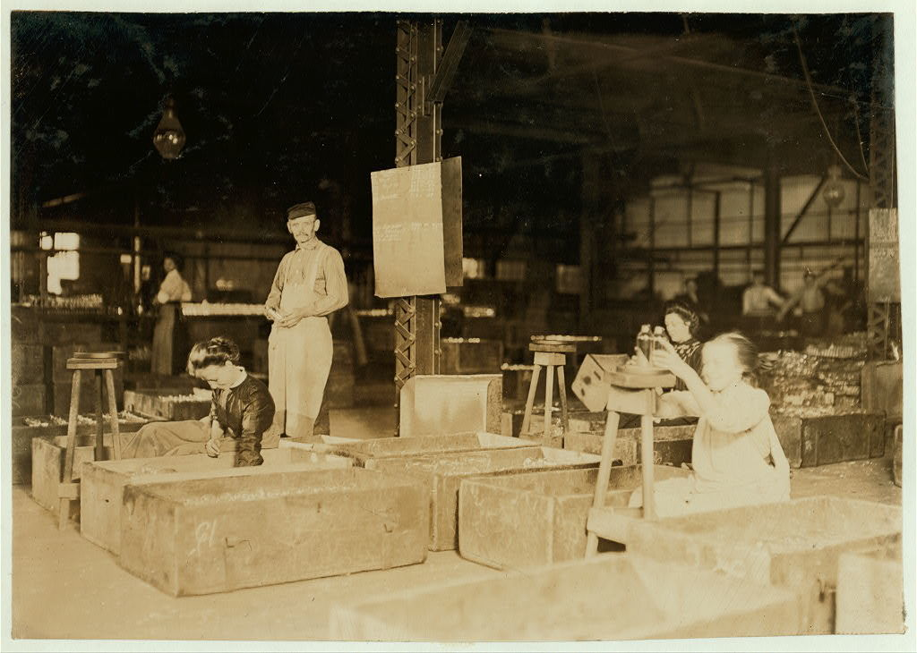 Girls in Packing Room. Central Glass Co., Wheeling West Virginia. Several very young girls pack here.  Location: Wheeling, West Virginia.