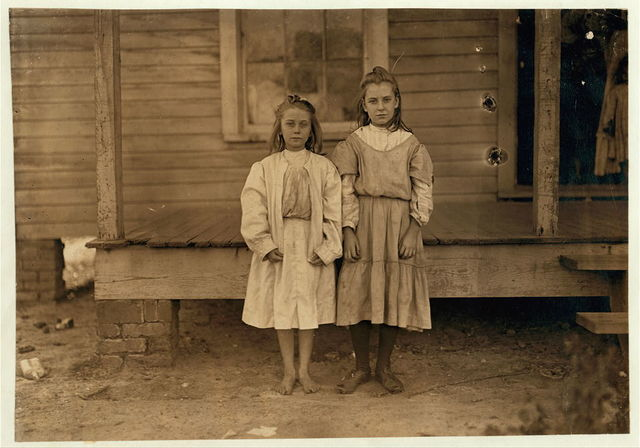 "Grace Harper (Looked 10 years old). Works in Lydia Mills, Clinton, S.C. Mother said she is very good hand at spinning. Been at it 3 years. Runs 4 and 5 sides, about 50 cents a day. Little sister Lettie helps. Mother said ""she is learnin'."" Looked 7 years old. Dec. 2/08. Witness Sara R. Hine.  Location: Clinton, South Carolina / Photo by Lewis W. Hine."