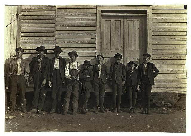 Group of boys from Wylie Mill, Chester, S.C. Spending Saturday behind the barn. Overseer came up and I couldn't get names or ages.  Location: Chester, South Carolina.