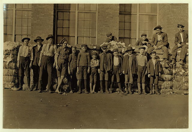 Group of boys working in Lancaster, S.C. Cotton Mills. Smallest boy in middle said has been in the mill off and on for 5 yrs. Spins now. Nov. 30, 1909[sic].  Location: Lancaster, South Carolina.