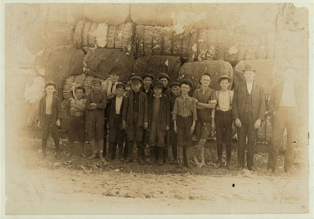Group of boys working in Lancaster S.C. Cotton mills. Smallest boy said he had worked in the mill off and on for five years. Spins now.  Location: Lancaster, South Carolina.