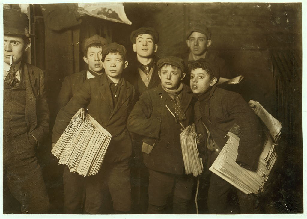 Group of Newsboys on Frankfort Street near World Building.  Witness, Fred McMurrry.  Location: New York, New York (State) / Photo by Lewis W. Hine.
