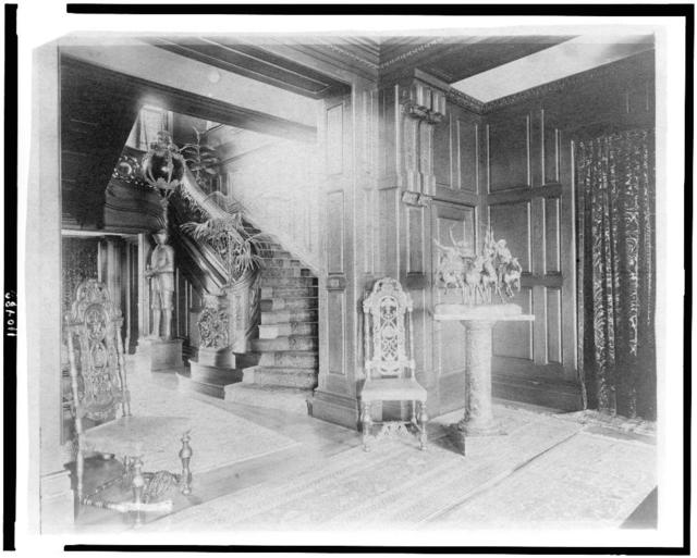[Hall and stairway, with suit of armor at left, and statue of cowboys on horseback at right, in home of Edmund Cogswell Converse, Greenwich, Connecticut]