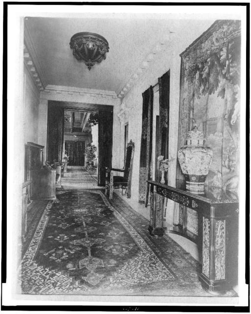[Hallway, with Oriental urn at right, in home of Edmund Cogswell Converse, Greenwich, Connecticut]