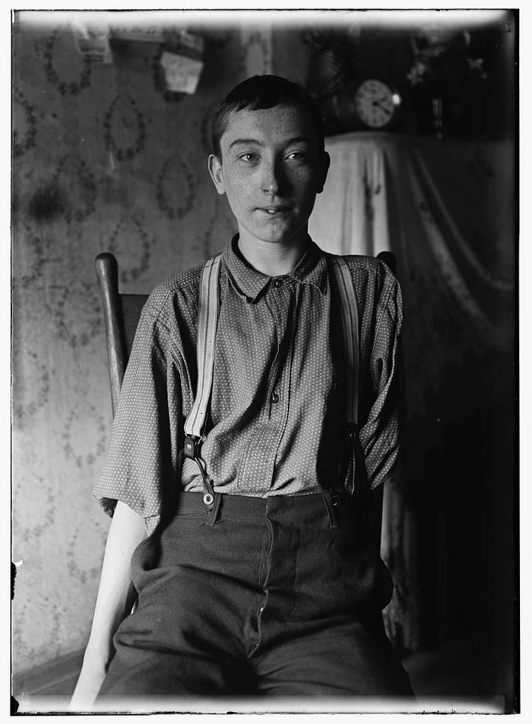 Harry McShane, 134 B'way i.e. Broadway, Cin. O. - 16 yrs. of age on June 29, 1908. Had his left arm pulled off near shoulder, and right leg broken through kneecap, by being caught on belt of a machine in Spring factory in May 1908. Had been working in factory more than 2 yrs. Was on his feet for first time after the accident, the day this photo was taken. No attention was paid by employers to the boy either at hospital or home according to statement of boy's father. No compensation Location: Cincinnati, Ohio