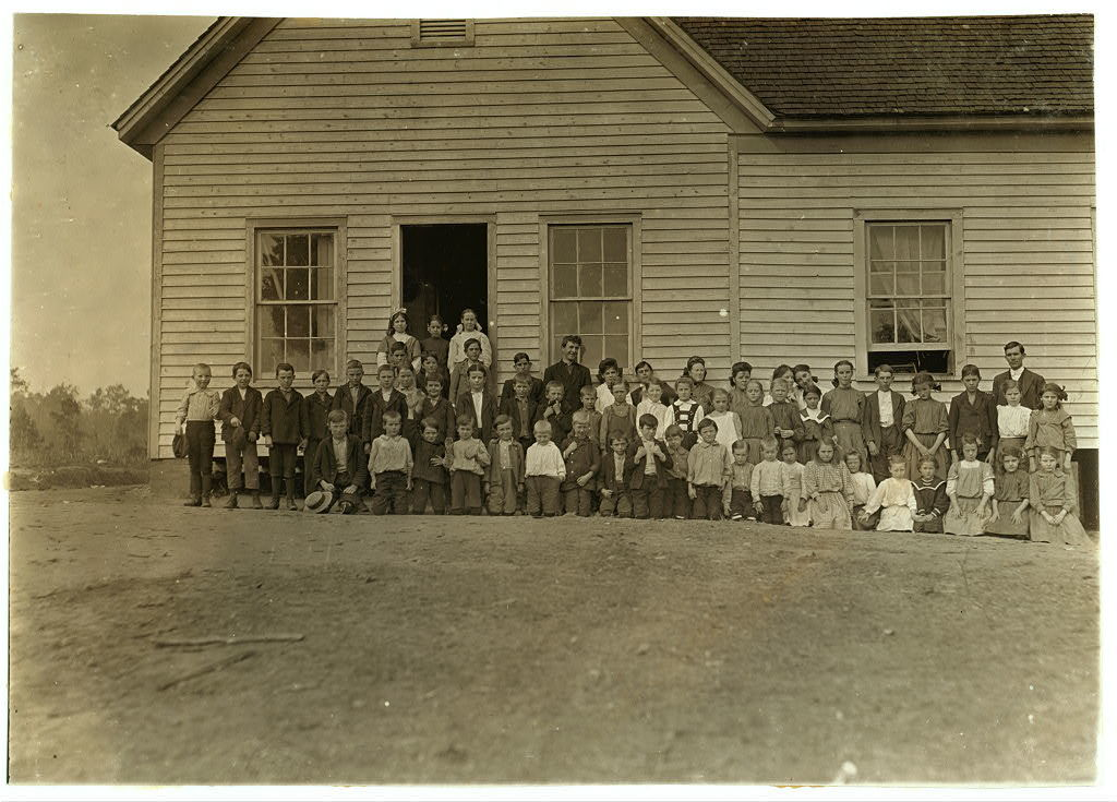 High Shoals (N.C.) School. This is average attendance. Enrollment is 80. Only one other school in town and about 15 attend that. See photo 279 (St. John's Mission School) Population of town is about 1000. Where are the rest of the children? This school is supported principally by the Mill Co. (Partly by County). Betterment work is being started. Mill.superintendent is very suspicious of Photographers. Couldn't get any of mill children. Photo. November 9, 1908.  Location: High Shoals, North Carolina / by Lewis W. Hine.
