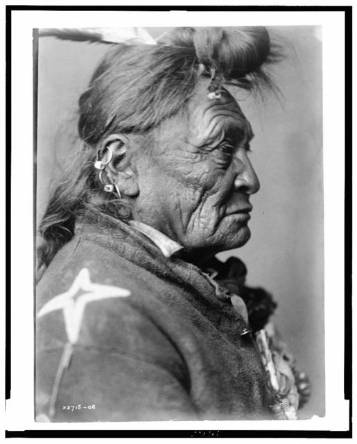 [Hoop On the Forehead, Crow Indian, Montana, head-and-shoulders portrait, facing right]