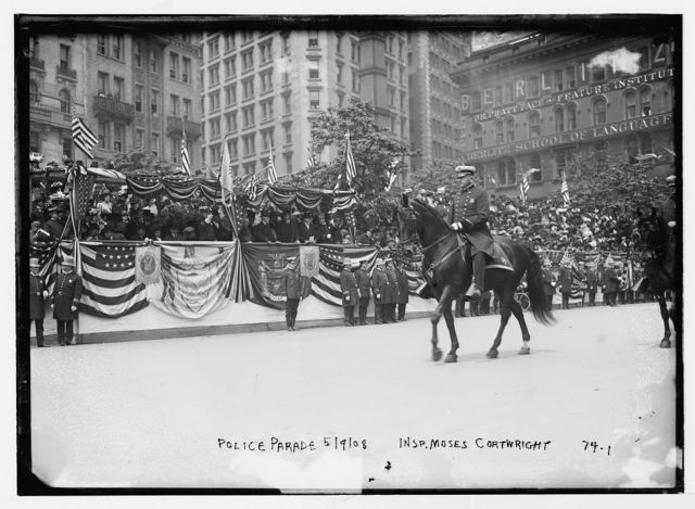 Inspector Moses Cortwright on horse in police parade, New York