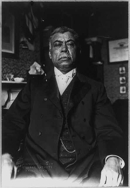 [Judson Lyons, half length portrait, seated, facing front. Middle-aged African American]