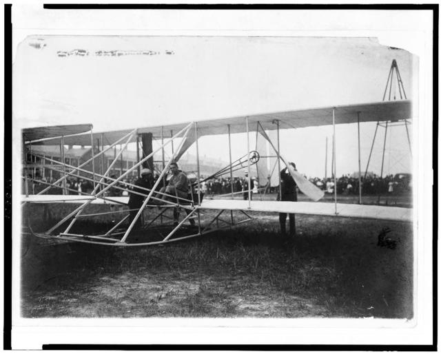 Lt. Selfridge & Mr. Wright stepping into the Wright aeroplane at Ft. Myer