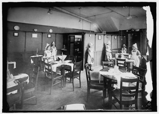 Lunchroom equipped by boys and conducted by girls, No. Benner St. Industrial School, Boston