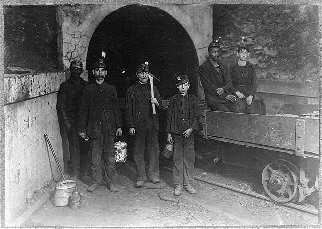 Main entrance, Gary W. Va. Mine. Trapper boy in center. Going to work 7 A.M. will be underground until 5:30 P.M. Trappers are paid $1. per day.  Location: Gary, West Virginia.