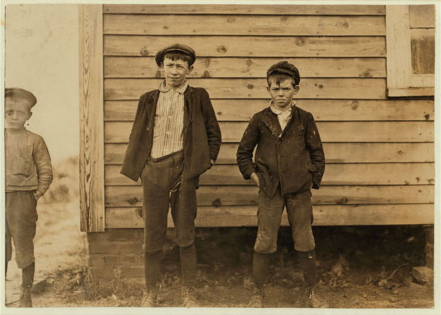 Maple Mills, Dillon, S.C. Lonnie Baker (tallest). Has doffed 4 years. Gets 40 cents a day. Bertie Baser--10 years old. 3 years in mill. Runs 3 sides = 30 cents a day.  Location: Dillon, South Carolina.