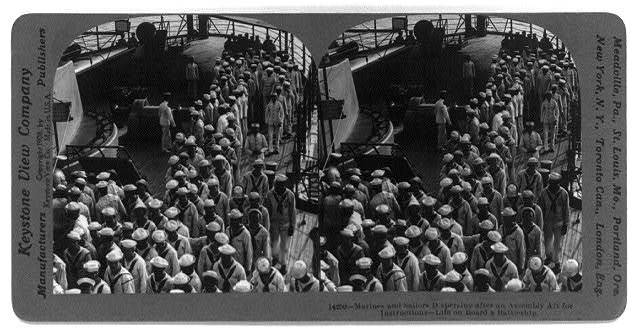 Marines and sailors dispersing after an assembly aft for instructions - life on board a battleship
