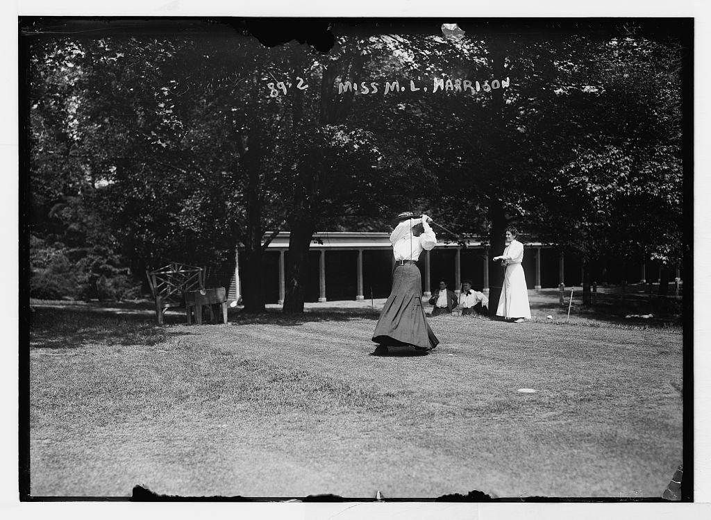 Miss M.L. Harrison, playing golf, Essex Country Club golf tournament