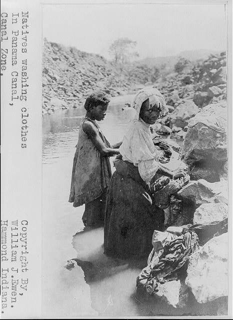 Natives washing clothes in Panama Canal, Canal Zone