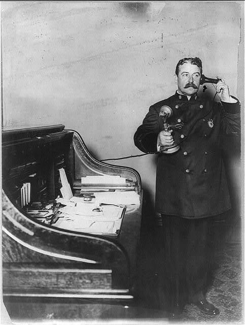 [New York City Police Dept. activities: Inspector McCafferty, on telephone]