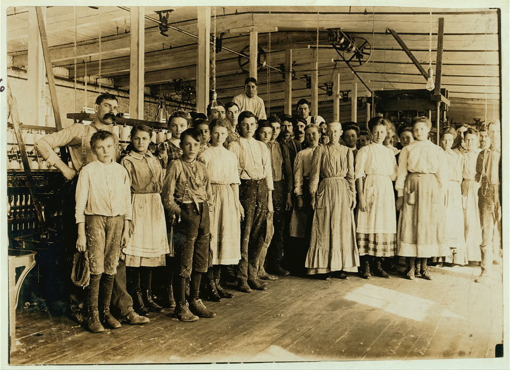 """Noon hour at Vivian Cotton Mills, Cheryville, N.C. Shows the character of the """"hands"""" in a better class mill, --well ventilated and lighted.  Location: Cherryville, North Carolina / Photo by Lewis W. Hine."""