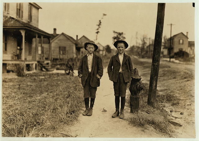 On streets near Daniel Mill. Lincolnton, N.C. Right hand boy--Dan Biggerstaff. 10 years old. Has worked 3 years. Goes to school now (he says). Left hand, John Erwin. Said 11 years old. Has worked nights.  Location: Lincolnton, North Carolina.
