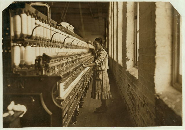 "One of spinners in Whitnel Cotton Mfg. Co. (N.C.) She was 51 inches high. Had been in mill 1 year, some at night. Runs 4 sides, 48 cents a day. When asked how old, she hesitated, then said ""I don't remember,"" Then confidentially, ""I'm not old enough to work, but I do just the same."" Out of 50 employees, ten children about her age.  Location: Whitnel, North Carolina."