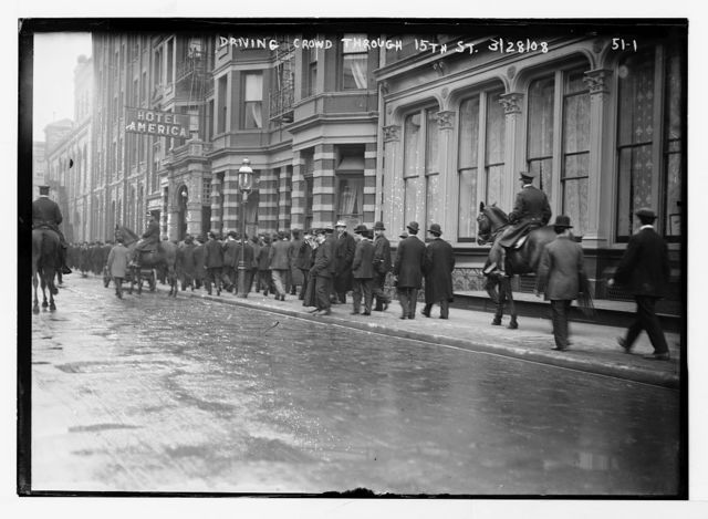 Police driving crowd through 15th St., New York