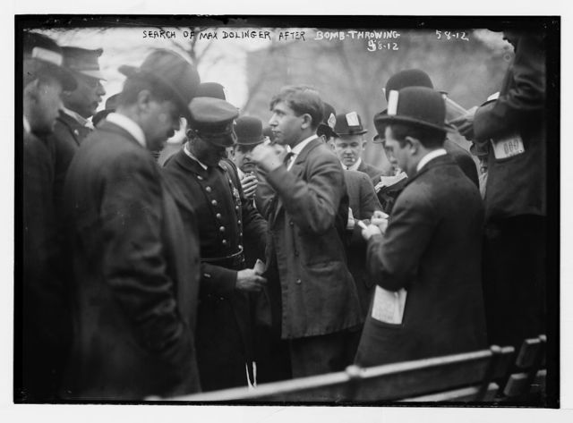 Police search Max Dolinger after bomb throwing, Union Square, anarchist riot, New York