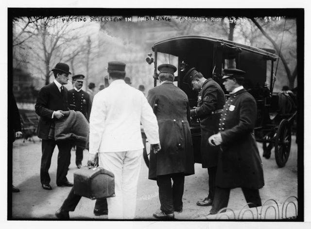 Policeman put Silverstein in horse-drawn ambulance at anarchist riot, Union Square, New York