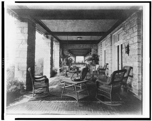 [Porch of E.C. Converse house, with wicker furniture, Greenwich, Connecticut]