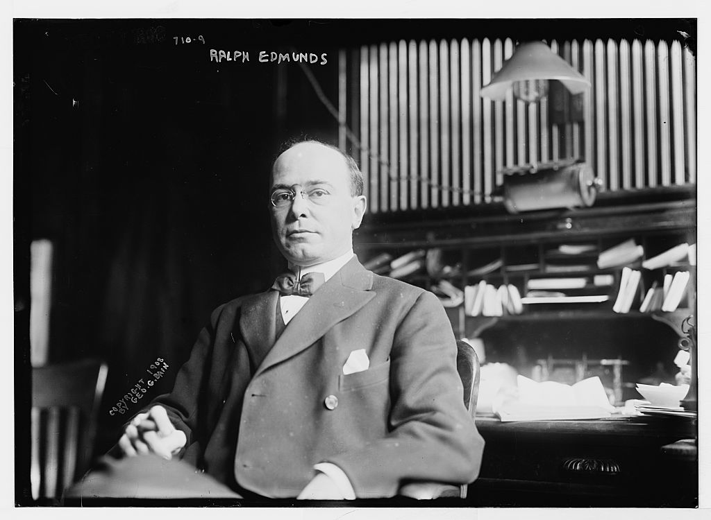 Ralph Edmunds, seated at desk