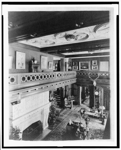 [Room with balcony, paintings, fireplace, grandfather clock, and elk head, in home of Edmund Cogswell Converse, Greenwich, Connecticut]