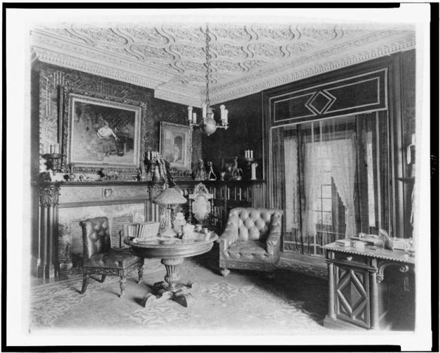 [Room with plasterwork ceiling, fireplace, and circular table, in home of Edmund Cogswell Converse, Greenwich, Connecticut]