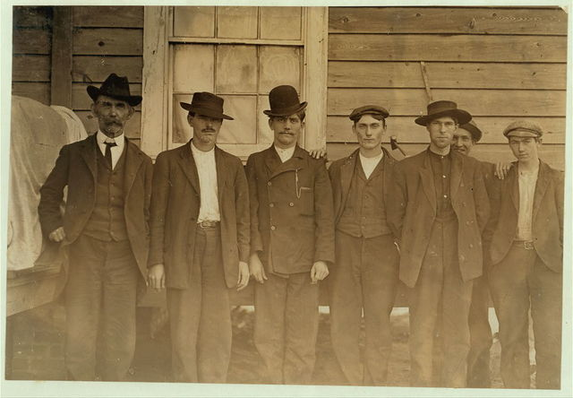 Row of mill men--Maple Mill, Dillon, S.C. Tallest man is the Baptist preacher J .H. Blanton. His son, the third from him, works in mill.  Location: Dillon, South Carolina.