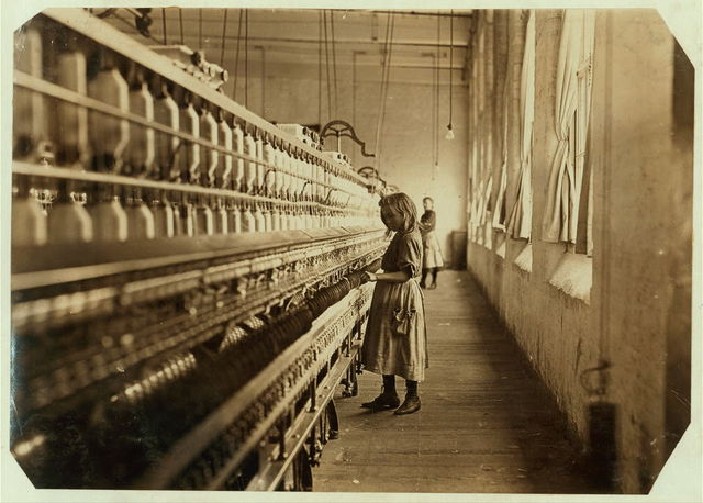 Sadie Pfeifer, 48 inches high, has worked half a year. One of the many small children at work in Lancaster Cotton Mills. Nov. 30, 1908. Location: Lancaster, South Carolina. / L.W. [Hine]