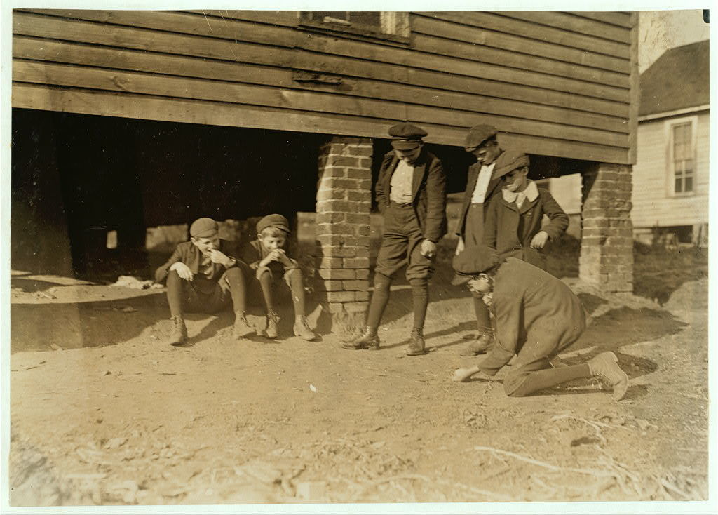 Salisbury, (N.C.) Cotton Mill. A game of marbles. All these boys work in the mill.  Location: Salisbury, North Carolina / Photo by Lewis W. Hine.