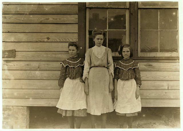 Springstein Mills, Chester, S.C. Maggie Wooten (Largest), creels on warper. Lillie Anderson--Oldest of two sisters. Been in mill five years. Runs only 4 sides. Minnie Anderson, - youngest- runs 8 sides. Been in mill 4 year. One finds many such cases where youngest sister does twice the amount of work. Nov. 28/08. Witness Sara R. Hine.  Location: Chester, South Carolina / Photo by Lewis W. Hine.