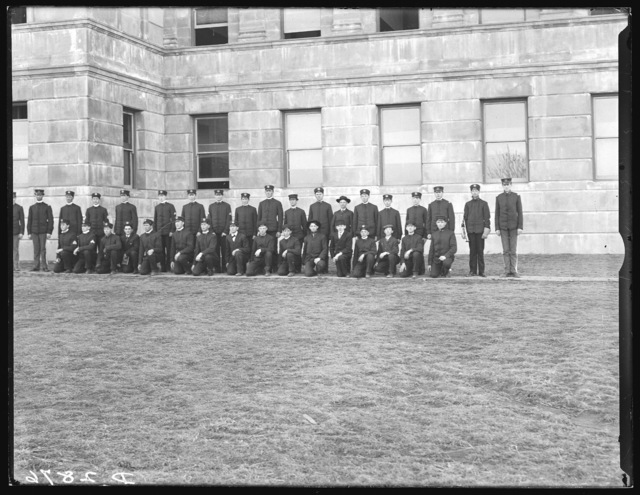 State Normal cadets in front of building at State Normalschool, Kearney, Nebraska