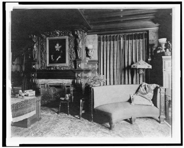 [Study with portrait of woman in Elizabethan dress, over fireplace, and curved sofa at right, in home of Edmund Cogswell Converse, Greenwich, Connecticut]