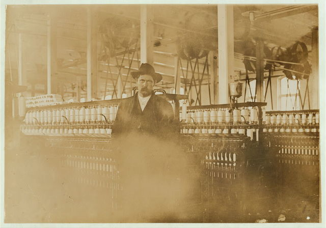 """T. A. Wright, Supt. of the Whitnell [sic?] (N.C.) Cotton Mfg. Co. A typical boss,--except hat he was less gruff and suspicious than most. Began mill work at 10 years old. Been at it 18 years. I asked him if he excepts to send his own children to work in the mill. He smiled grimly, """" Not if I keep my health, They're going to get an education."""" He said parents are responsible for so many children in the mills. Father loafs just as soon as children get old enough to work. Dec. 22, 08.  Location: Whitnel, North Carolina / Photo by Lewis W. Hine."""
