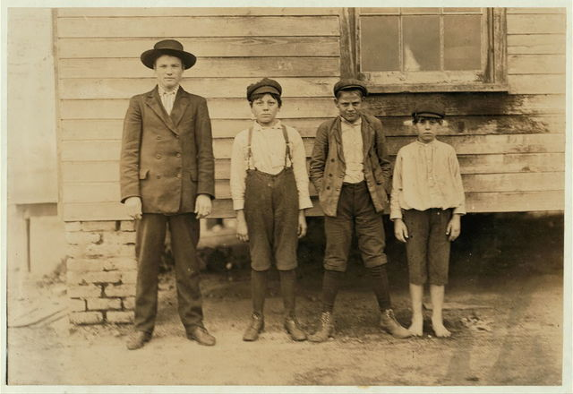 (Tallest) Sam Bigham, Eureka Cotton Mills. Been in mill 10 years. (Next) Washey Dover--Been in 3 years. (Next) Lloyd Barnado--2 years in mill. (Smallest) Ernst Floyd--10 years old, 52 inches high. Been in mill 2 years. Spins--60 cents a day. Witness S.R. Hine.  Location: Chester, South Carolina.