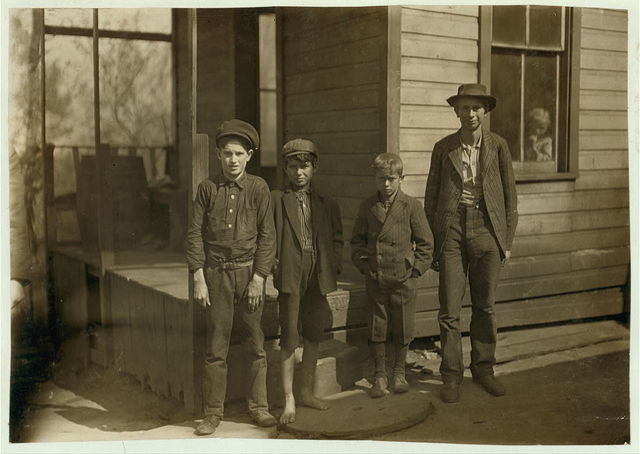 These boys (and one other small one, who is not present) and their father, work in Monongah Glass Works. Father gets $1.75 a day - one boy 125 a day 4 get 80 cents a day. Total 6.20 a day. Live in a tumble down house. What is the trouble?.  Location: Fairmont, West Virginia.