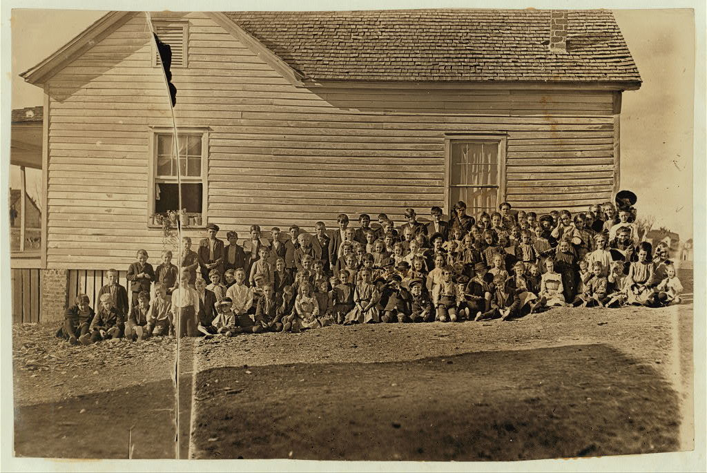 This is where the mill children go to school. Lancaster, S.C. Enrollment 163-- attendance, usually about 100. There are over 1,000 operatives in the mill. These are all that go to school from this mill settlement, which is geographically a part of Lancaster, but on account of the taxes has been kept just out of the corporate limits. Nov. 30/08.  Location: Lancaster, South Carolina / Photo by Lewis W. Hine.
