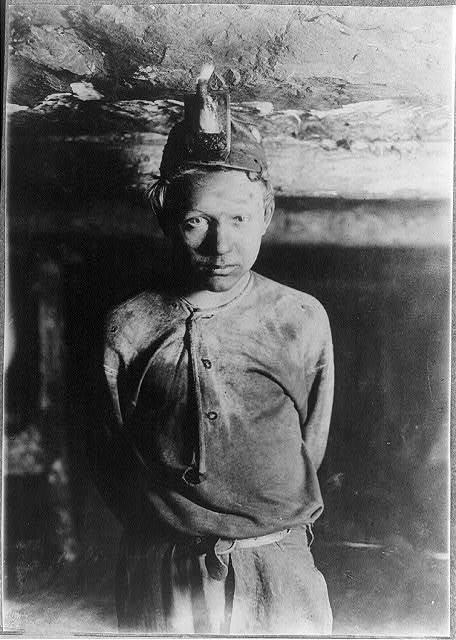 Trapper Boy, Turkey Knob Mine, Macdonald, W. Va. Boy had to stoop on account of low roof, photo taken more than a mile inside the mine. Witness E. N. Clopper.  Location: MacDonald, West Virginia.