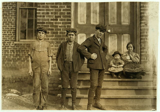 Trenton Mill, Gastonia, N.C. Tom Jenkins (left hand end) 13 years old, been in mill 3 year. Walter Jenkins, 15 years old. 4 years in mill. John Glover, (right hand) 16 years old, at mill 5 years. Closing hour, 3 p.m. Saturday, Nov.  Location: Gastonia, North Carolina.