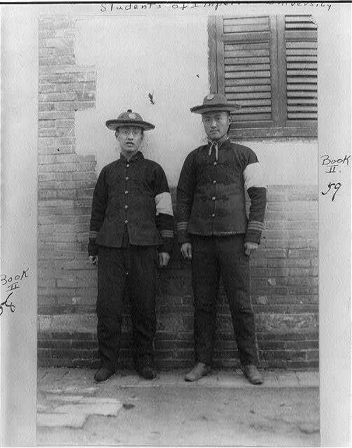 [Two Imperial University students wearing white arm bands on left arm of military uniform; mourning death of dowager Empress Tzu Hsi, 1908?, Peking.]